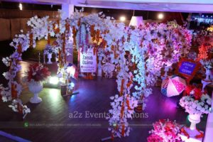 floral entrance decor, cross ring decorated with mehndi stuff