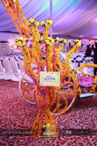 decorative trees, fresh flowers, walkway decor