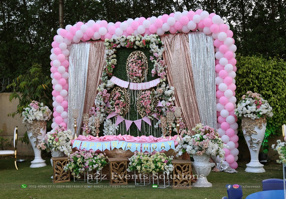 birthday stage, thematic stage, floral backdrop, decor specialists
