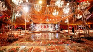 glass dance floor, hanging chandeliers, fresh flowers decor, vip, stage